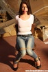 Hot red chick in jeans with a gag-ball gets roped tightly to the chair