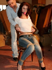 Hot red chick in jeans with a gag-ball gets - XXX Dessert - Picture 3