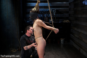 Hot chick with a gag-ball and her feet stretched and shackled gets fucked hard with a dildo stick - XXXonXXX - Pic 9