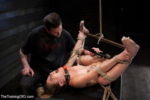 Hot chick with a gag-ball and her feet stretched and shackled gets fucked hard with a dildo stick - XXXonXXX - Pic 10