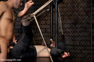Dark-haired girl in special bondage tight and her hands roped to a stick with baskets full of water gets her head fucked by her master - XXXonXXX - Pic 3