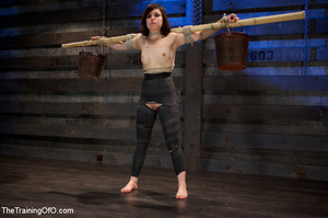 Dark-haired girl in special bondage tight and her hands roped to a stick with baskets full of water gets her head fucked by her master - XXXonXXX - Pic 5