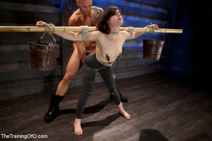 Dark-haired girl in special bondage tight and her hands roped to a stick with baskets full of water gets her head fucked by her master - XXXonXXX - Pic 6