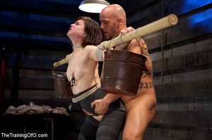 Dark-haired girl in special bondage tight and her hands roped to a stick with baskets full of water gets her head fucked by her master - XXXonXXX - Pic 8