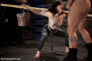 Dark-haired girl in special bondage tight and her hands roped to a stick with baskets full of water gets her head fucked by her master - XXXonXXX - Pic 11