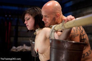 Dark-haired girl in special bondage tight and her hands roped to a stick with baskets full of water gets her head fucked by her master - XXXonXXX - Pic 13