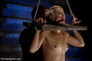 Blonde ponytailed chick gets bound tightly and tortured with pins in dirty cold cellar - XXXonXXX - Pic 1