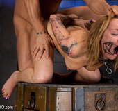 Tatooed blonde girl bound and suspended upside…