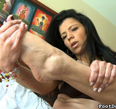 Hot latina milf enjoys looking at her sexy toes
