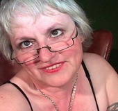 Nasty granny in glasses fondling her huge body in…