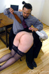 Hot secretary in glasses and stockings gets spanked right at her working