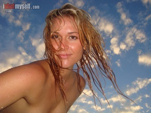 Very hot blonde chick in an orange bikini taking it off to present her awesome tits in the sunset sea - XXXonXXX - Pic 5