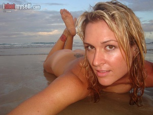 Very hot blonde chick in an orange bikini taking it off to present her awesome tits in the sunset sea - XXXonXXX - Pic 6