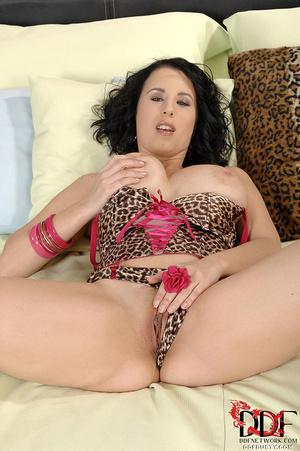 Curly brunette vixen in leopard corset a - XXX Dessert - Picture 4