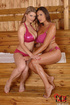 Two stacked babes in pink lingerie get sweaty in the sauna and lick each