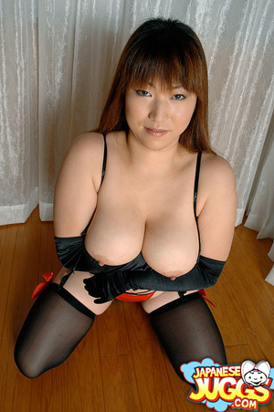 Busty Asian MILF in a res thong, black stockings and gloves demonstrating her huge titties - XXXonXXX - Pic 5