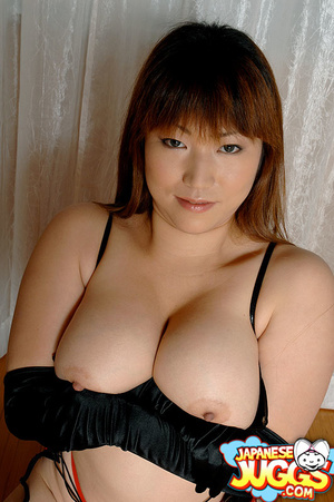 Busty Asian MILF in a res thong, black stockings and gloves demonstrating her huge titties - XXXonXXX - Pic 6