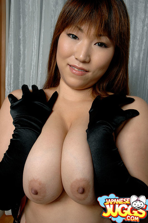 Busty Asian MILF in a res thong, black stockings and gloves demonstrating her huge titties - XXXonXXX - Pic 9