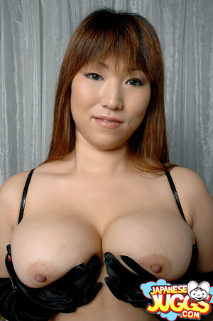 Busty Asian MILF in a res thong, black stockings and gloves demonstrating her huge titties - XXXonXXX - Pic 10
