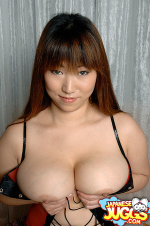 Busty Asian MILF in a res thong, black stockings and gloves demonstrating her huge titties - XXXonXXX - Pic 13