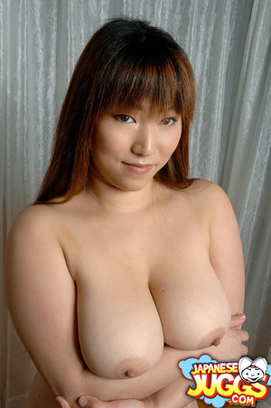 Busty Asian MILF in a res thong, black stockings and gloves demonstrating her huge titties - XXXonXXX - Pic 15