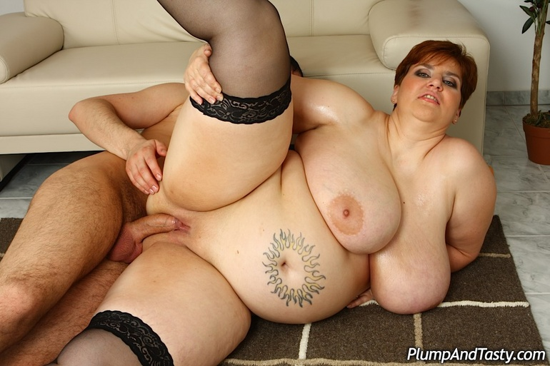 Huge bitch in black stockings takes it in doggy style - Picture 13