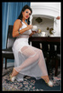 Luxurious brunette mom in a white long dress and…