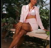 Hot milf in a suit undresses in the garden to…