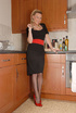 Ponytailed mom in vintage stockings and red high…
