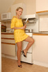 Hot blonde mom in yellow dress undresses in the…