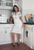 Brunette mom in a white marine dress and retro…