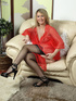 Hot blonde vixen in a red gown and retro stockings…