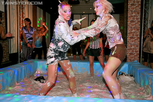Two bodacious blonde babes in sexy clothes and stockings having fun in the muddy pool - XXXonXXX - Pic 3