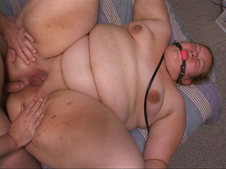 Ugly fatso with a gag-ball gets her pooper and cunt - Picture 4