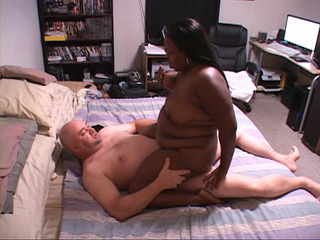 Lustful black fatty enjoys riding a white meaty dick - Picture 2