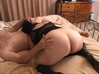 Lustful milf in a black dress and high boots giving head - Picture 3