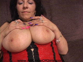 Slutty brunette plump mom in stockings and a red top - Picture 2