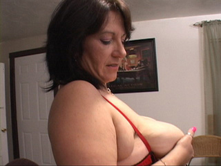 Slutty brunette plump mom in stockings and a red top - Picture 4