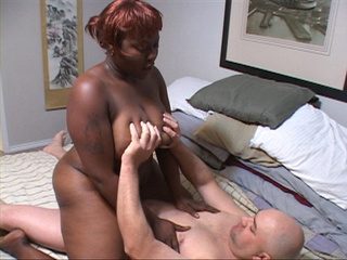 Big-titted black grandmother jumping on a thick boner - Picture 1
