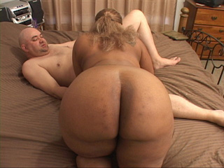 Fair-haired black whore with big tits sucking man's meat - Picture 1