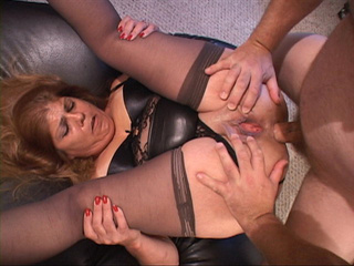 Chubby latina grandmother in sexy lingerie and stockings - Picture 1