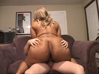 Fat ass ebony slut in a blonde wig riding on a man's - Picture 3