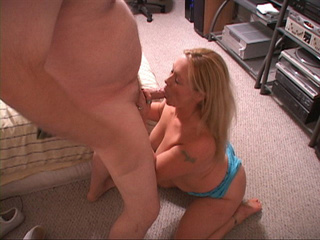 Lustful blonde housewife in blue shorts giving head - Picture 1