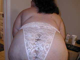 Huge brunette fatso in a white lace panties shows off - Picture 3