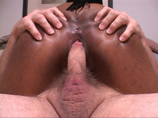 Chubby black mom riding on a white cock backwards - Picture 3