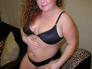 Curly red fatty in a black atlas lingerie gets ready for - Picture 2