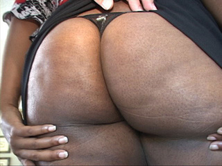 Ponytailed ebony slut with big booty gives head to her - Picture 1