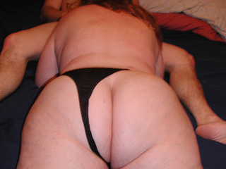 Fat red bitch in sexy black lingerie demonstrates her - Picture 1