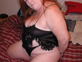 Fat red bitch in sexy black lingerie demonstrates her - Picture 2