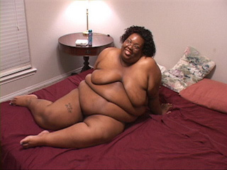 Slutty black fatty is happy to suck a white cock before - Picture 1